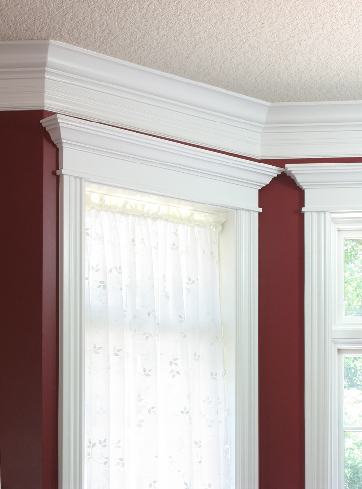 Inspiration for a timeless family room remodel in Minneapolis with red walls