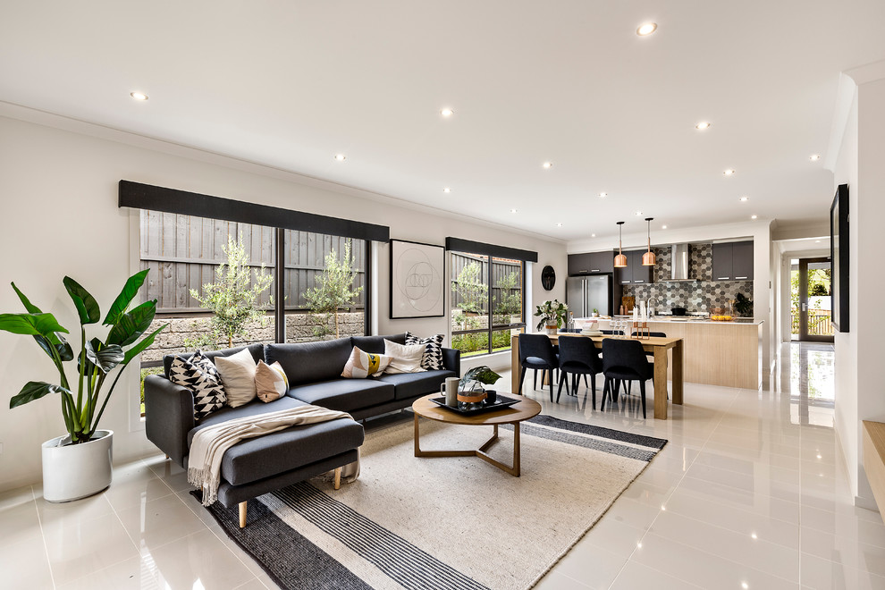 Example of a large danish open concept white floor family room design in Melbourne with white walls