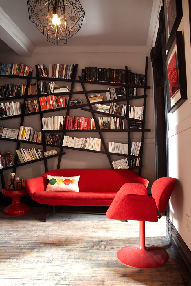 Example of a trendy family room library design in Toronto with beige walls
