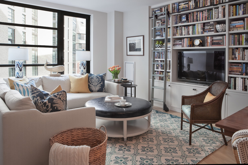 Family room - mid-sized transitional open concept light wood floor and beige floor family room idea in Boston with gray walls and a tv stand