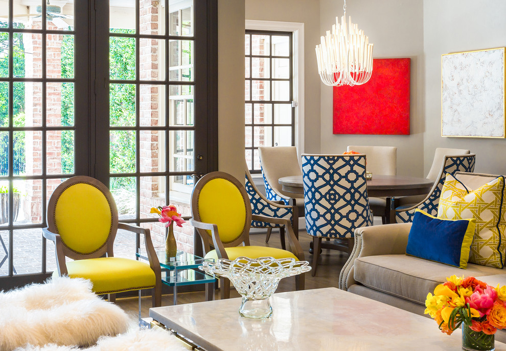 Inspiration for a mid-sized eclectic open concept family room remodel in Houston with gray walls and a media wall