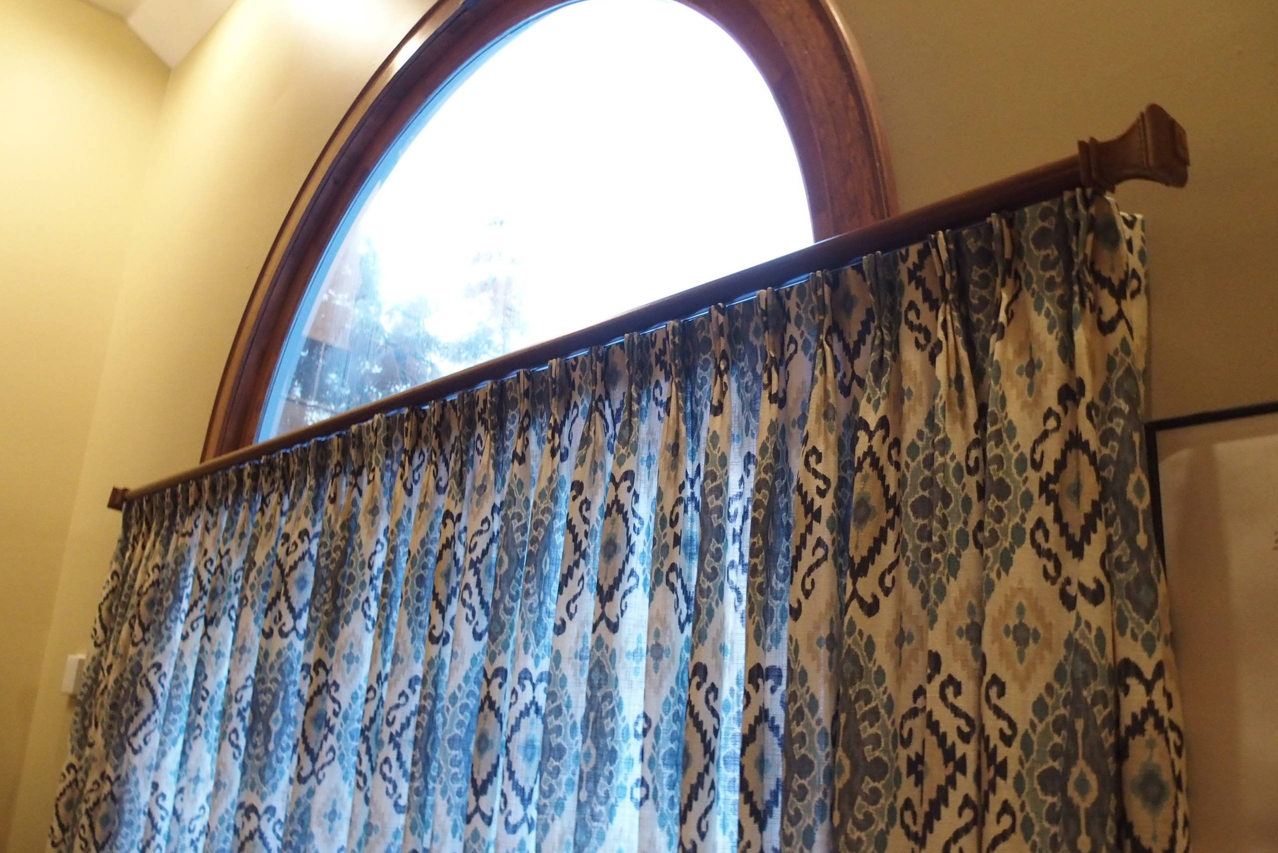 Draperies on a Twelve Foot Door and Window in a large Family Room