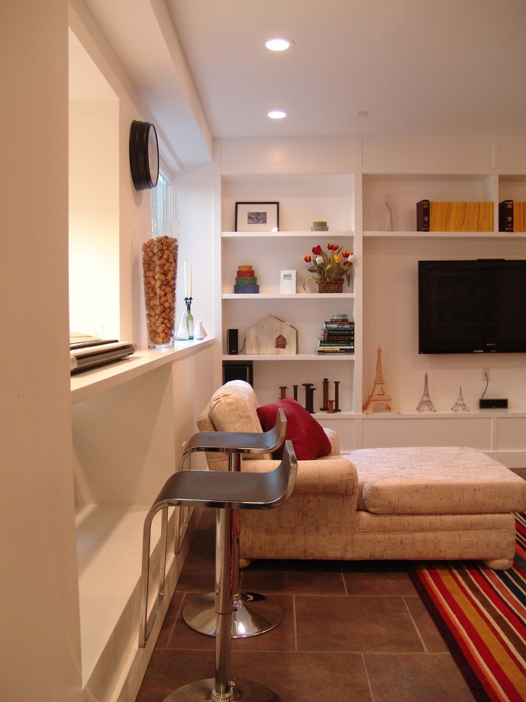 Example of a trendy family room design in Atlanta with white walls and a wall-mounted tv