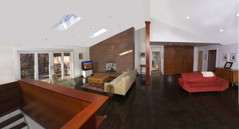 Example of a trendy open concept dark wood floor family room design in Atlanta with white walls and a corner tv