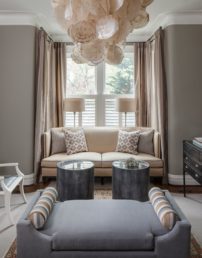 Example of a mid-sized transitional enclosed dark wood floor and brown floor family room design in DC Metro with gray walls, no fireplace and no tv