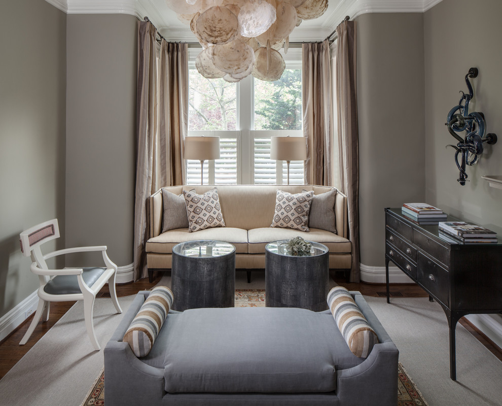 Family room - mid-sized transitional enclosed medium tone wood floor and brown floor family room idea in DC Metro with gray walls, no fireplace and no tv