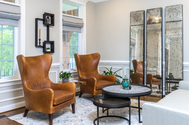 Example of a mid-sized transitional enclosed dark wood floor and brown floor family room design in DC Metro with beige walls, no fireplace and no tv