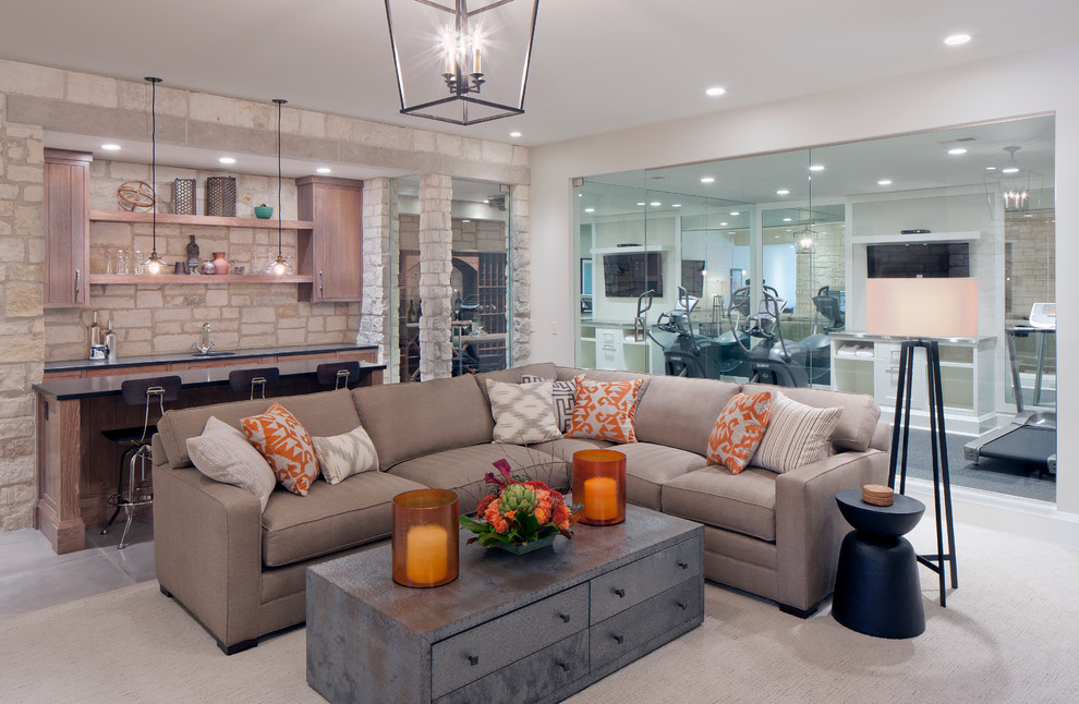 Example of a transitional family room design in Grand Rapids with a bar
