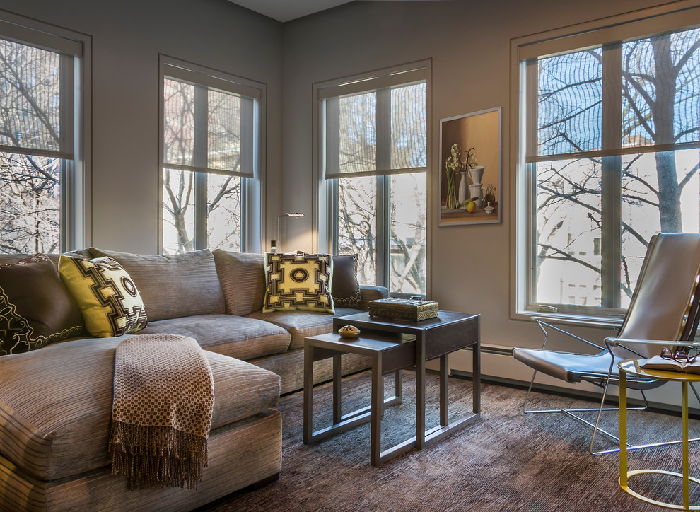 Trendy carpeted family room photo in Chicago with beige walls