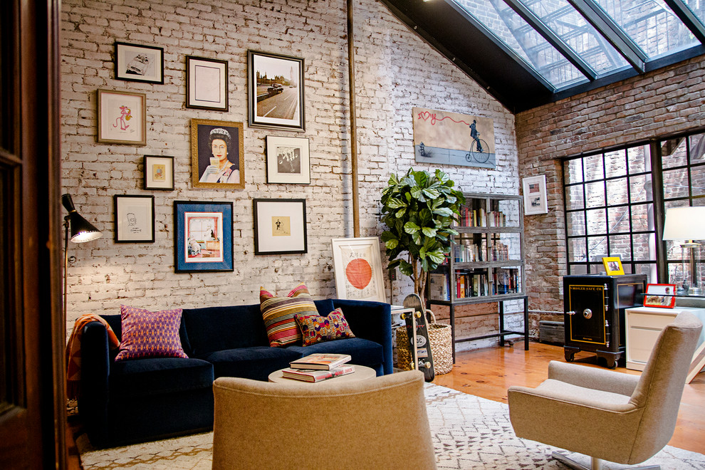 Inspiration for a large industrial enclosed medium tone wood floor and brown floor family room remodel in New York with multicolored walls