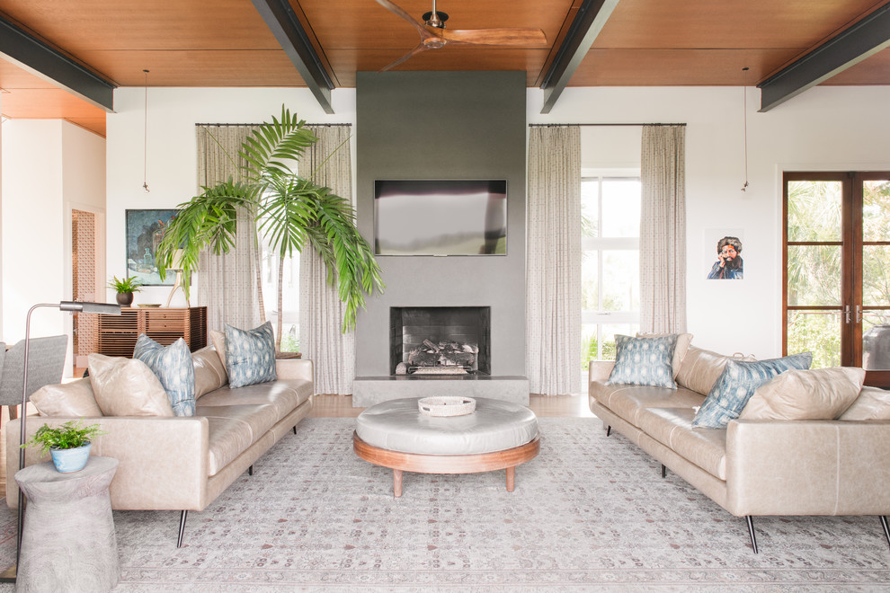 Beach style open concept family room photo in Charleston with white walls, a standard fireplace and a wall-mounted tv