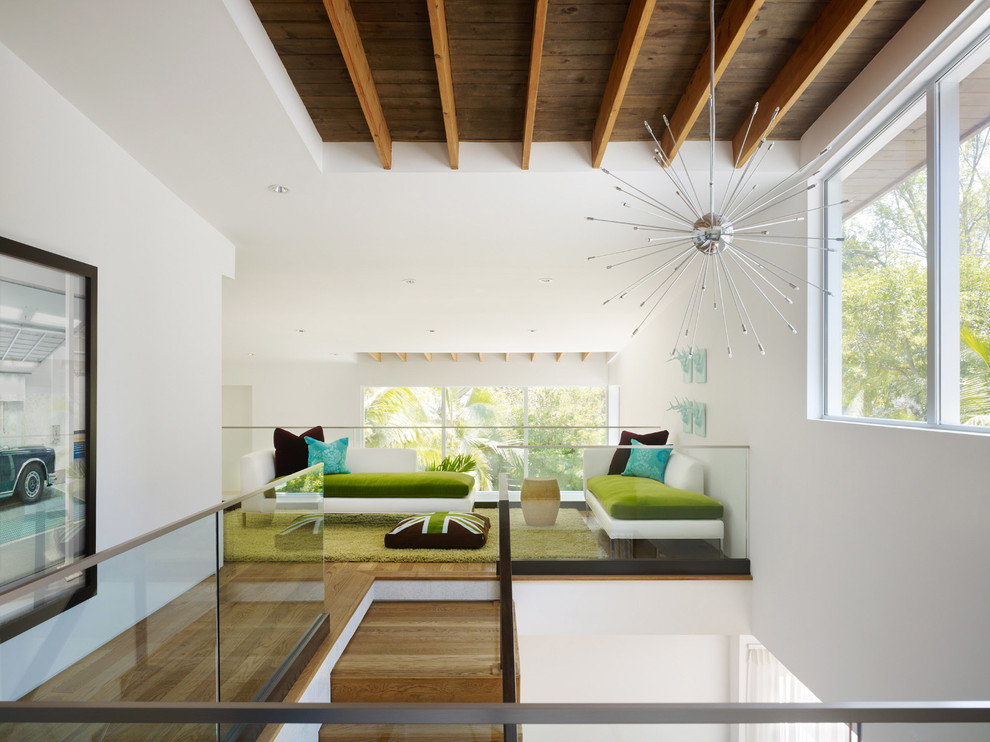Mid-century modern loft-style family room photo in Los Angeles with white walls