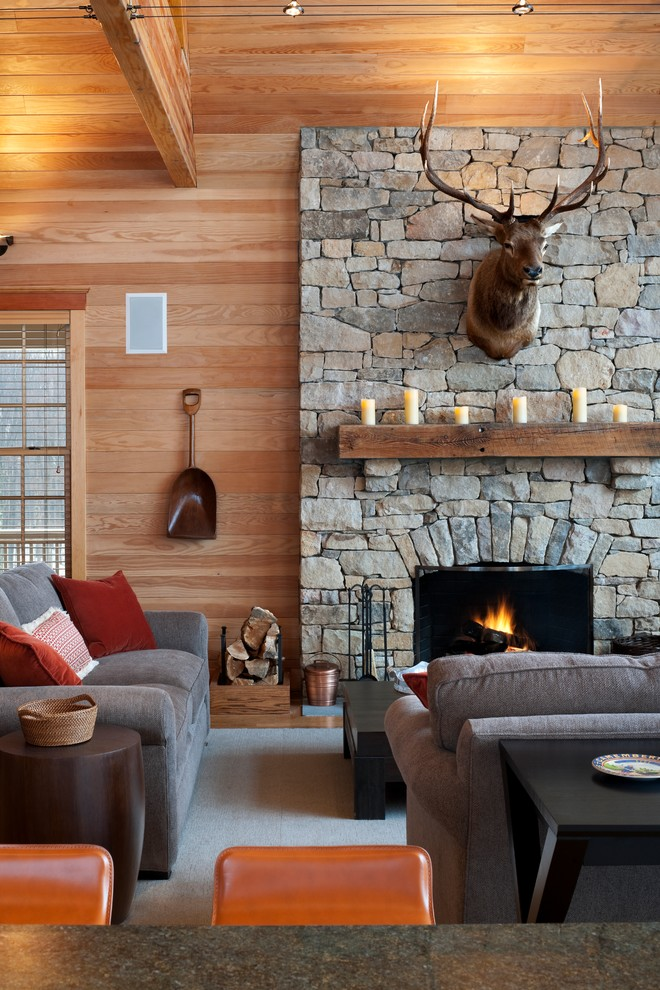 Family room - rustic family room idea in Philadelphia with a standard fireplace, a stone fireplace and no tv