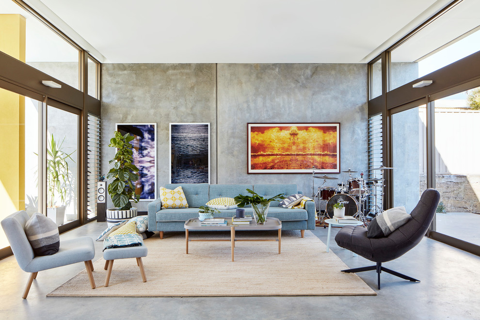 Inspiration for an industrial concrete floor and gray floor family room remodel in Perth with a music area and gray walls