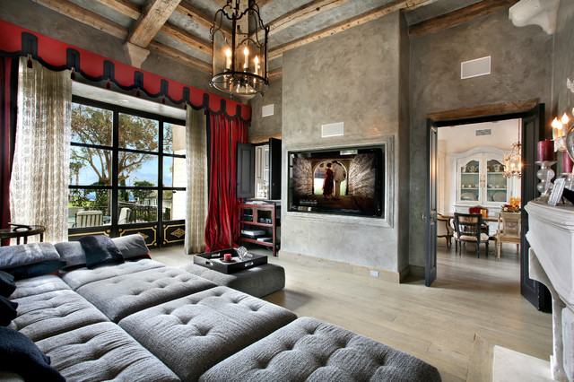 Tuscan light wood floor family room photo in Orange County with gray walls and a wall-mounted tv