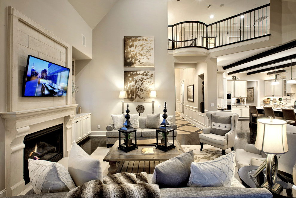 Transitional family room photo in Charlotte with gray walls