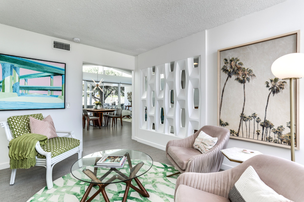 Mid-sized mid-century modern enclosed carpeted and gray floor family room photo in Other with white walls and no tv
