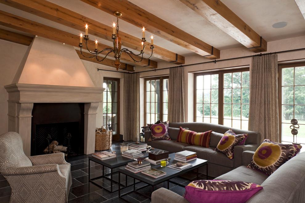 Foto de sala de estar sin televisor con paredes beige y todas las chimeneas