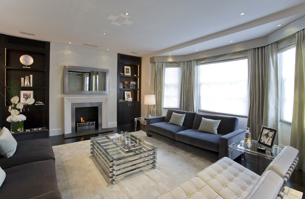 Mid-sized trendy open concept dark wood floor and brown floor family room photo in DC Metro with a standard fireplace and a metal fireplace