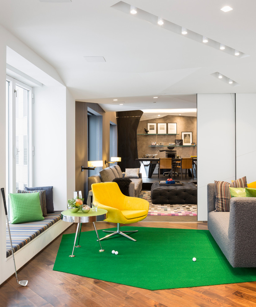 Inspiration for a mid-sized contemporary enclosed medium tone wood floor game room remodel in Chicago with white walls