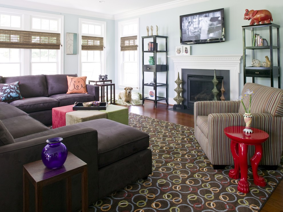 Mid-sized eclectic open concept dark wood floor and brown floor family room photo in DC Metro with blue walls, a standard fireplace, a plaster fireplace and a wall-mounted tv