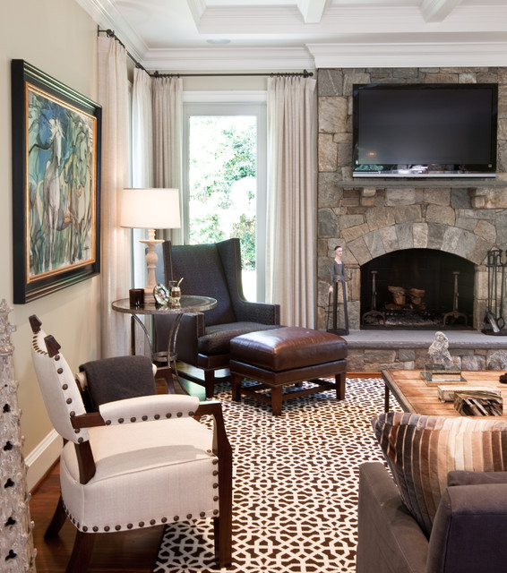 Example of a classic dark wood floor family room design in DC Metro with beige walls, a standard fireplace, a stone fireplace and a wall-mounted tv