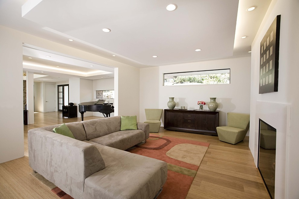 Inspiration for a contemporary open concept bamboo floor family room remodel in San Francisco with white walls and a standard fireplace