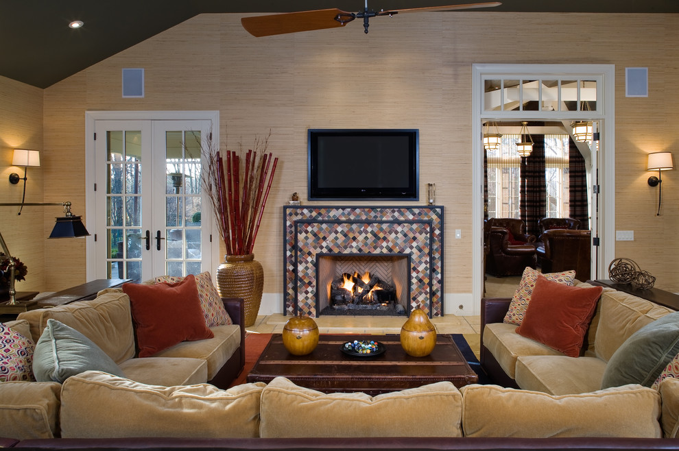 Inspiration for a mid-sized timeless open concept medium tone wood floor family room remodel in Philadelphia with a tile fireplace, beige walls, a standard fireplace and a wall-mounted tv