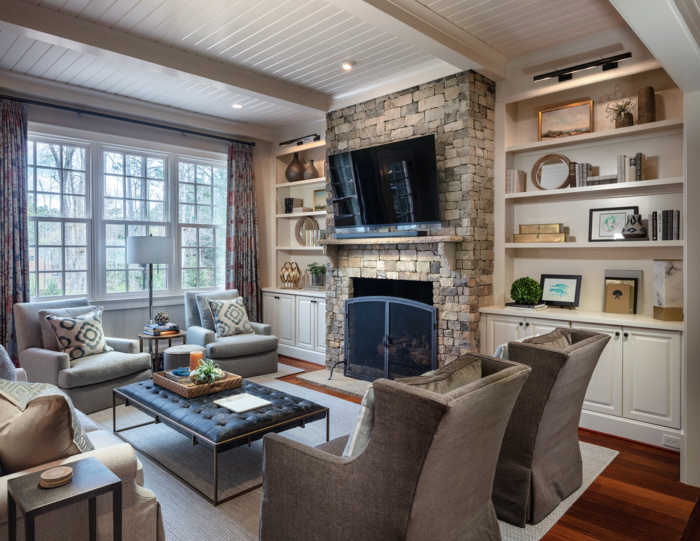 Inspiration for a mid-sized timeless open concept brown floor and dark wood floor family room remodel in Atlanta with white walls, a standard fireplace, a stone fireplace and a wall-mounted tv