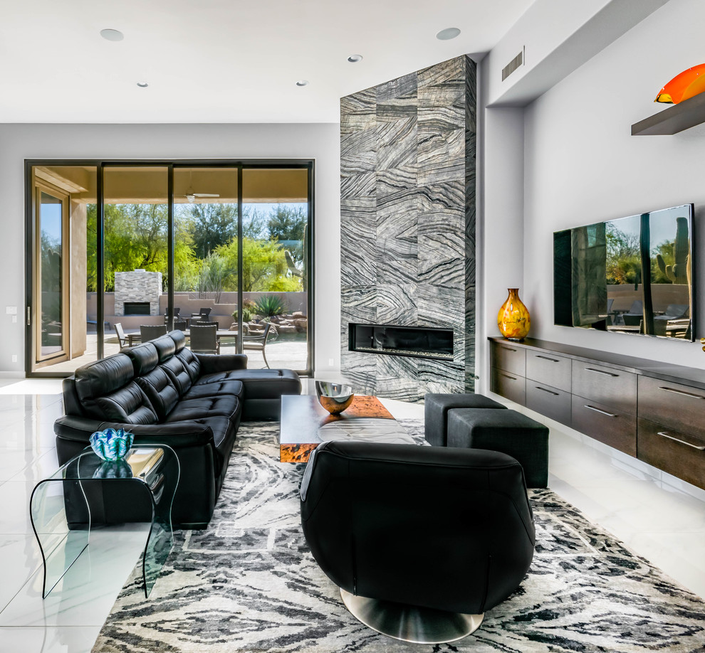 Inspiration for a large contemporary open concept marble floor family room remodel in Phoenix with gray walls, a tile fireplace, a wall-mounted tv and a ribbon fireplace