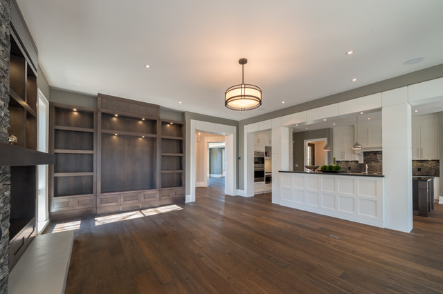 Inspiration for a large open concept medium tone wood floor family room remodel in Toronto with gray walls