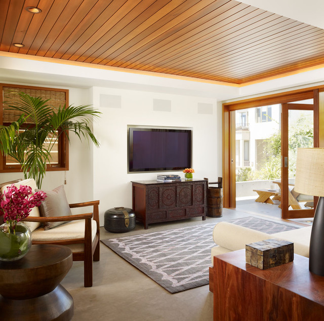 tropical family room by Rockefeller Partners Architects