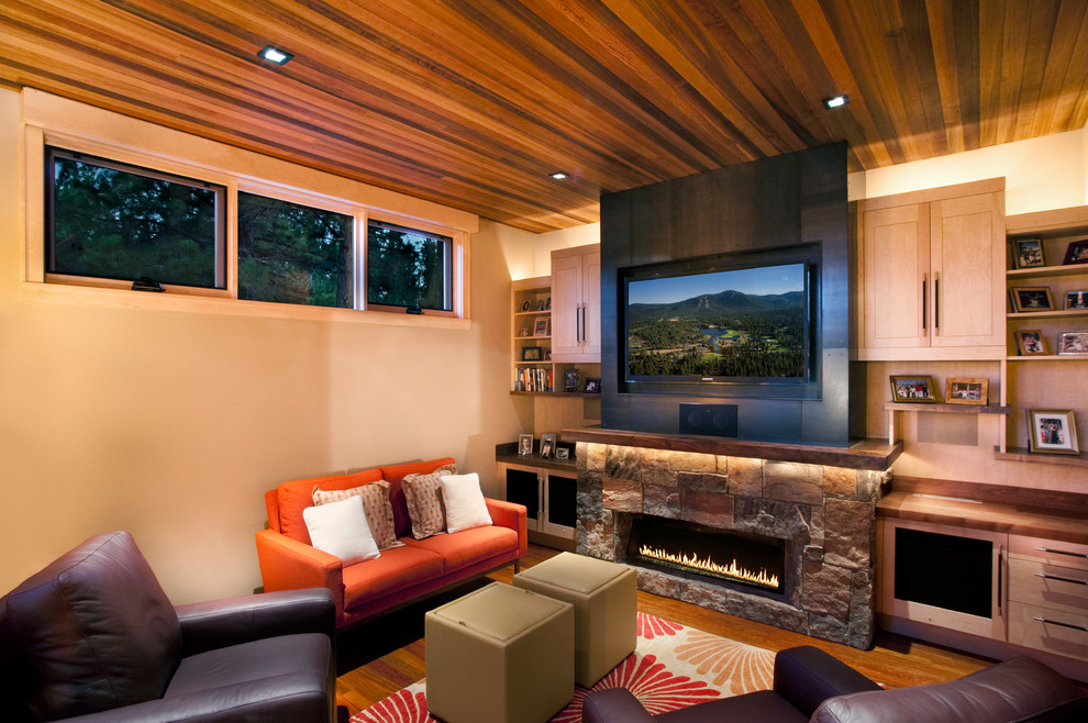 Example of a mountain style family room design in Sacramento with a stone fireplace