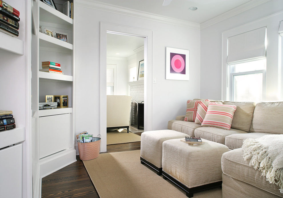 Small beach style enclosed dark wood floor family room photo in Newark with white walls and no fireplace