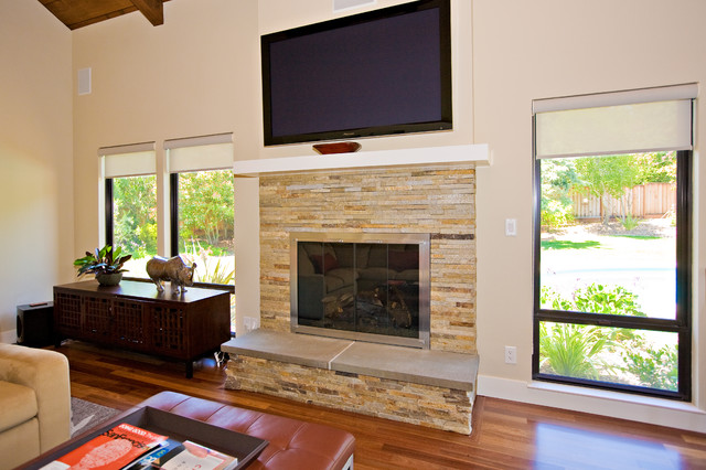 Family room stone masonry fireplace with flat tv for Fireplace half stone