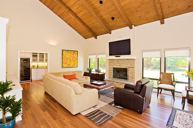 family room, stone masonry fireplace with flat TV, opens to butler pantry contemporary-family-room