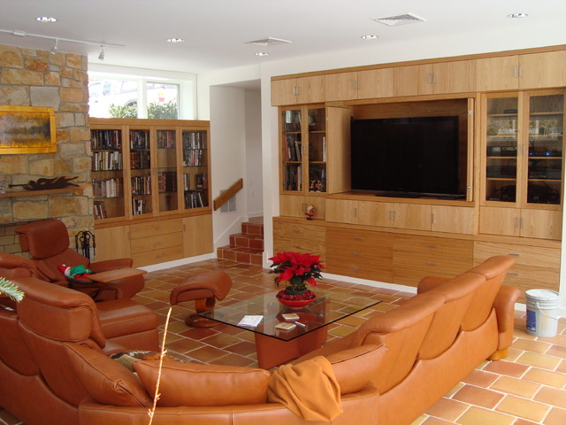 Family Room with entertainment center, bookcases and chimney contemporary-family-room