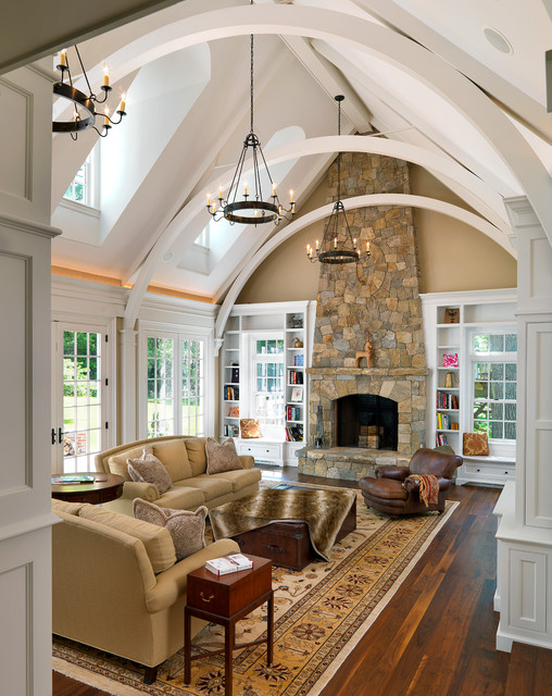 Elegant dark wood floor family room photo in Boston with beige walls, a standard fireplace and a stone fireplace