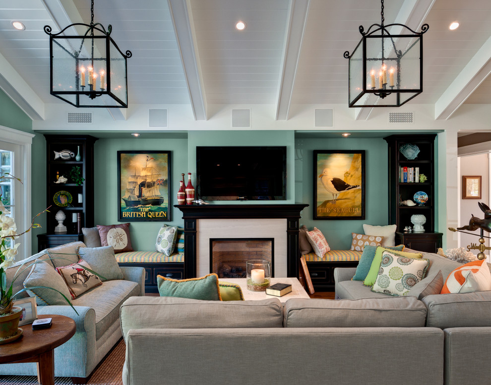 Inspiration for a mid-sized timeless open concept family room remodel in San Francisco with a standard fireplace, a wall-mounted tv, green walls and a stone fireplace