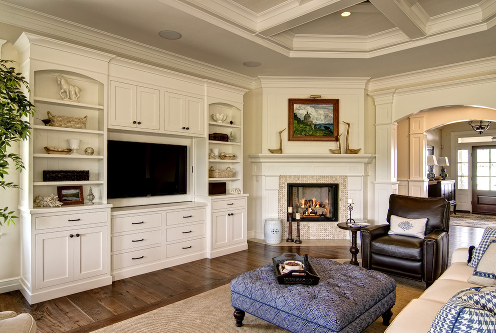 Inspiration for a timeless family room remodel in Other with a corner fireplace and a tile fireplace