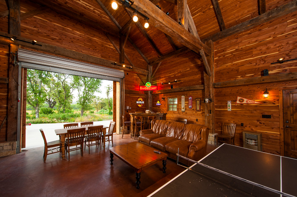 Country open concept concrete floor game room photo in Austin with brown walls