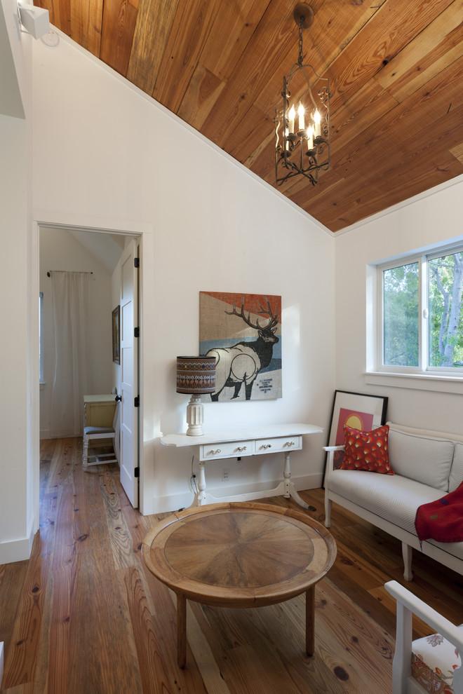 Farmhouse medium tone wood floor family room photo in Austin with white walls