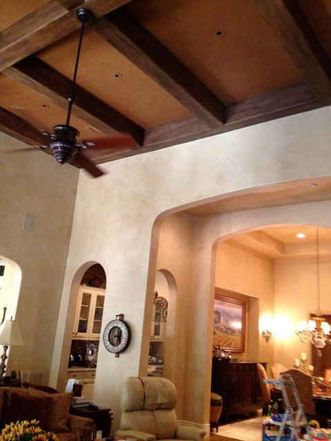 Faux finished walls, beams and ceiling insets mediterranean-family-room
