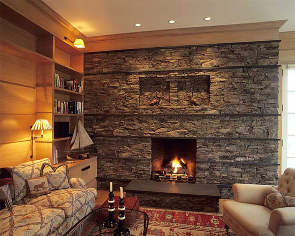 Faux stone fireplace using apli lava faux stone panels. Great color that wraps up the earth toned style. It creates a cozy yet beautiful living room space.