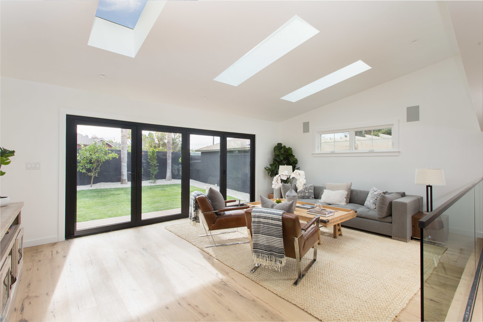 Example of a mid-sized cottage open concept family room design in Los Angeles with white walls