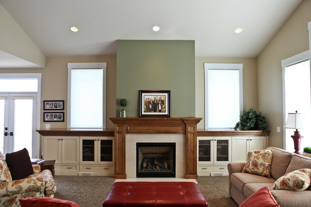 Fireplace In Family Room With Built Ins Under Windows  Traditional Family Room