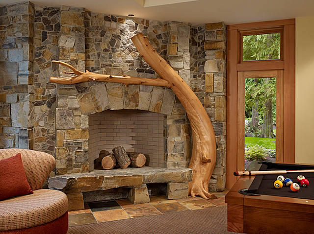 Fireplace in rec room of cedar haven home contemporary Corner rock fireplace designs