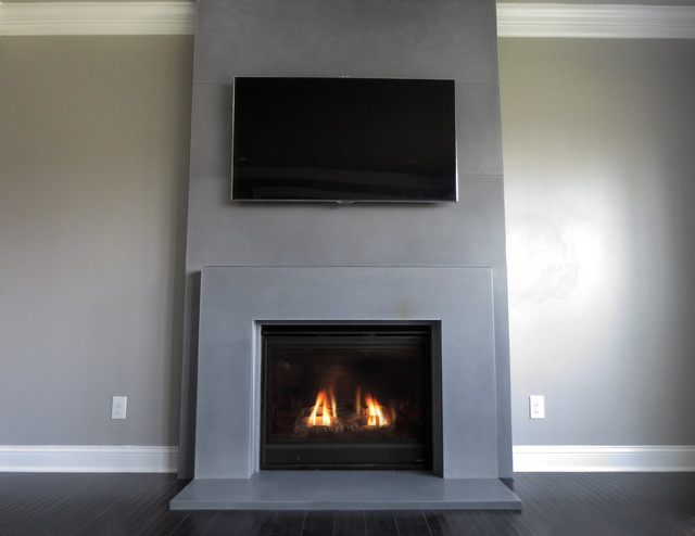 Fireplace surround contemporary family room new york for Concrete mantels and hearths