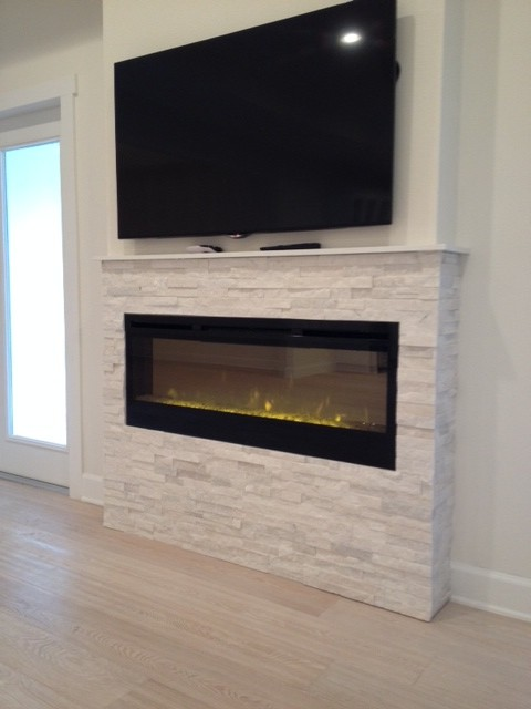 Fireplace with glacier white stone facade - Transitional ...