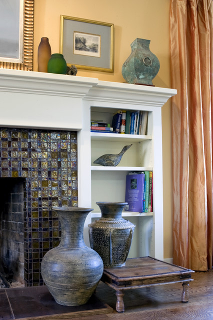 Fireplace with glass tile and custom wood mantel traditional-family-room